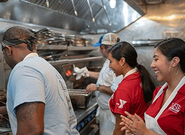 Photo of students in kitchen