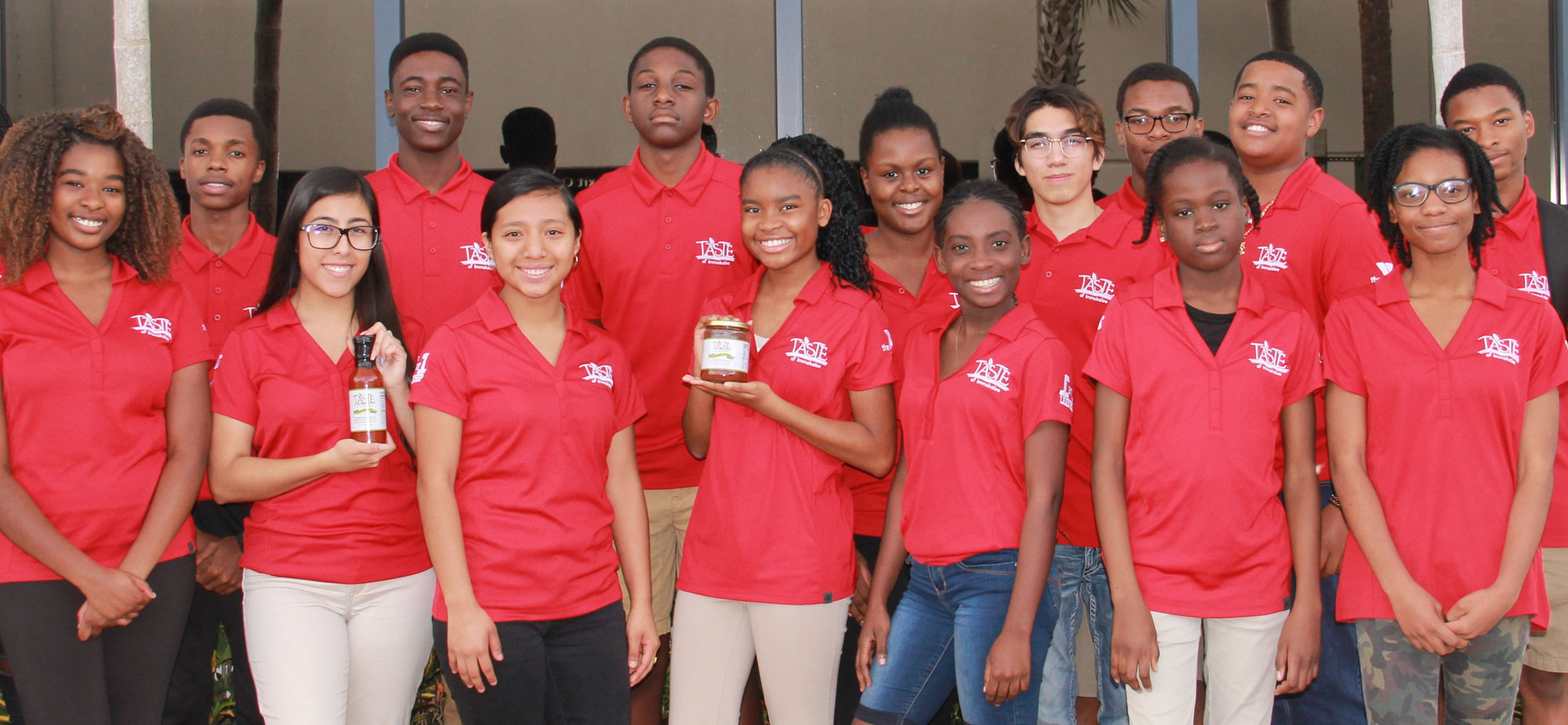 Photo of Students for Taste of Immokalee holding product