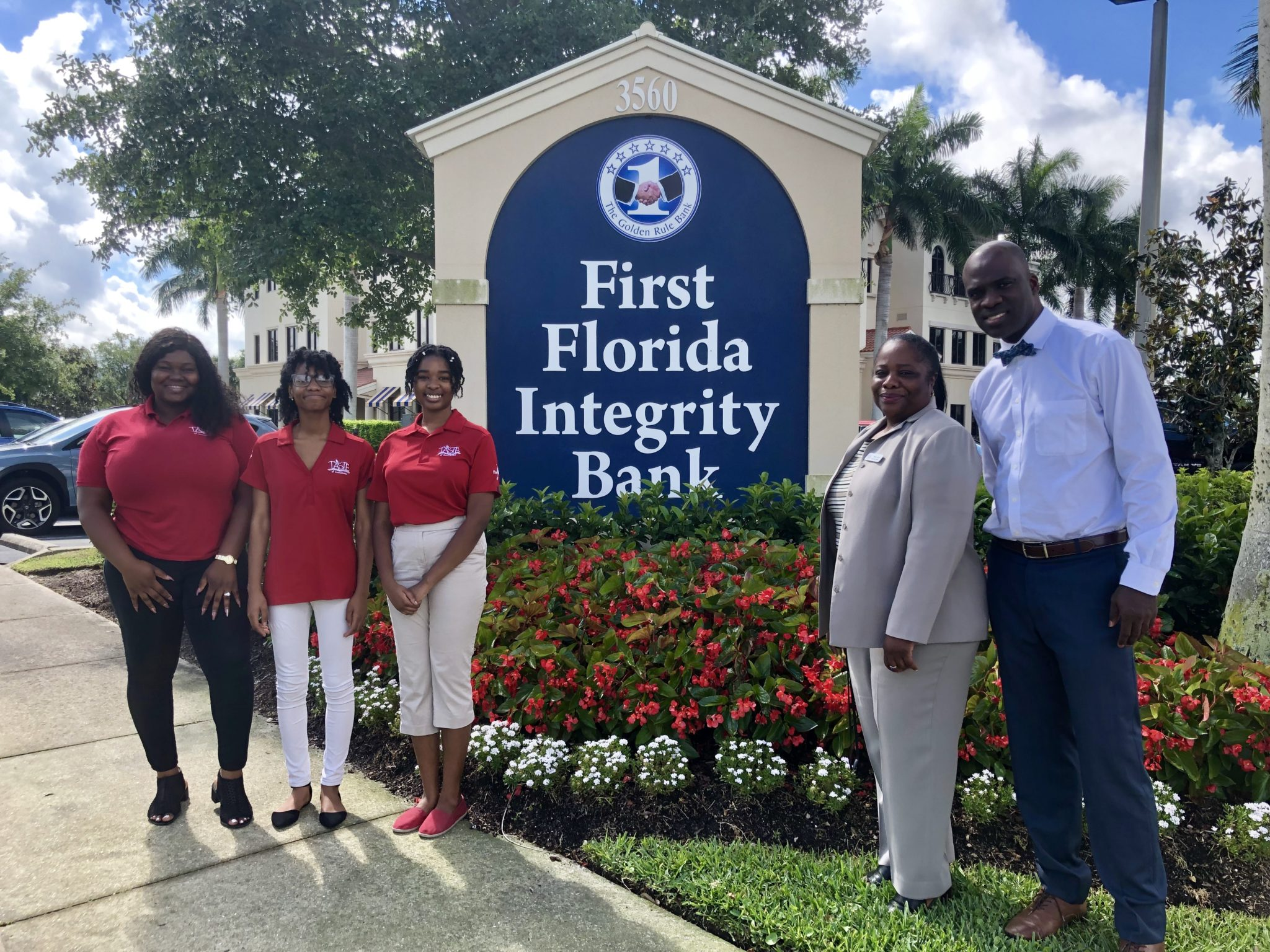 Team with First Florida Bank Sign